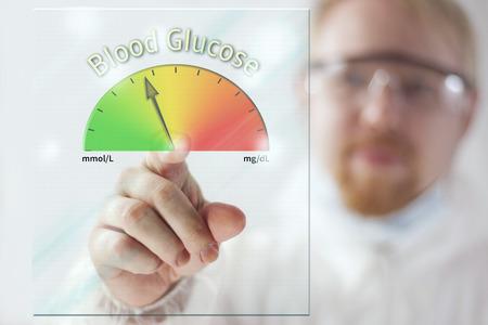 血糖メーター画面で示す医師 写真素材