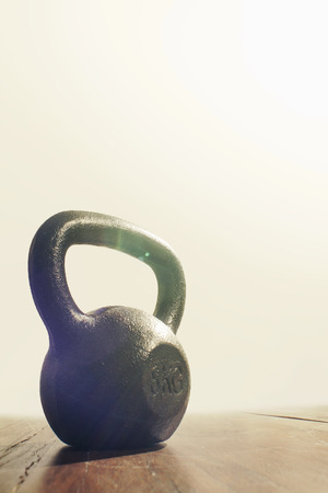 Light Shining Gloriously on Kettlebell Weight Stock Photo