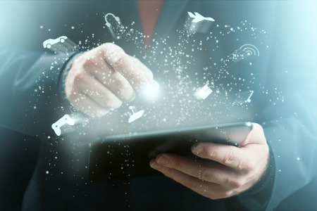 Game Related Icons Sparkling Around Tablet Computer Stock Photo