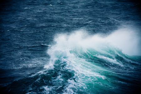 Wave Breaking and Spraying  in Strong Winds