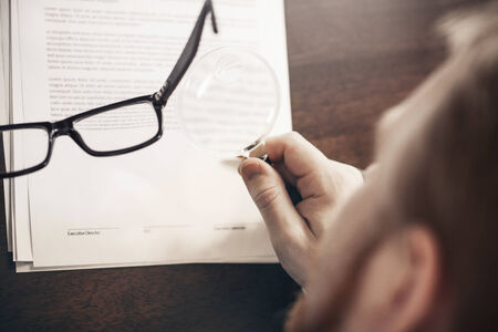 Inspecting Agreement with Magnifying Glass photo