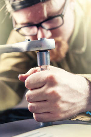 socket wrench: Man Working with Socket Wrench