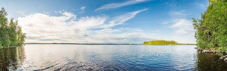Summer Lake at Calm Day. Wide Angle Panorama Stitched of Several Photos.