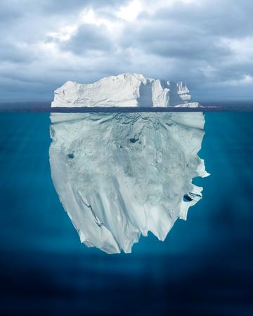 Mostly Underwater Iceberg Floating in Ocean
