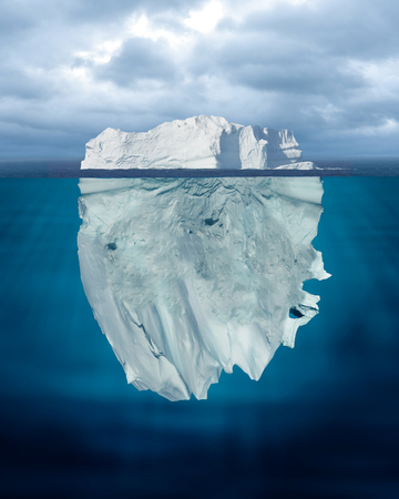 Mostly Underwater Iceberg Floating in Ocean