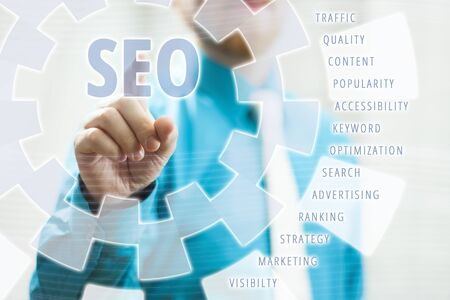 Businessman Pointing SEO Text in Virtual Screen Concept With Associated Keywords photo