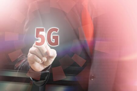 Businessman Pointing 5G Icon in Communication Concept Image