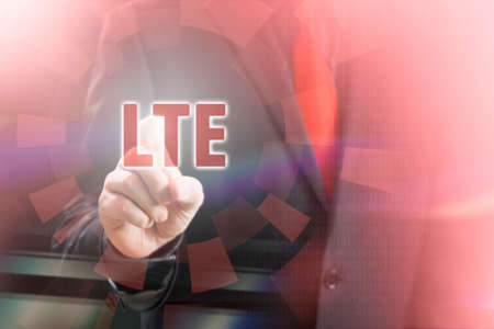 lte: Businessman Pointing LTE Text in Communication Concept Image
