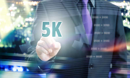 Businessman Pointing 5K Resolution in Communication Concept Image Stock Photo