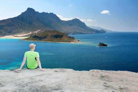 Runner Man Having a Break with Beautiful View Over Mediterranean Coastline Stock Photo