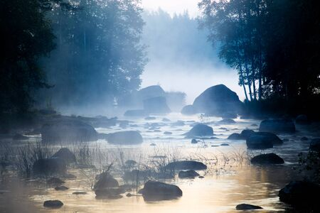 Mist Rising over Shallow River Stock Photo