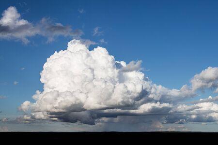 Majestic Forming Cumulonimbus Pouring Rain in Distance