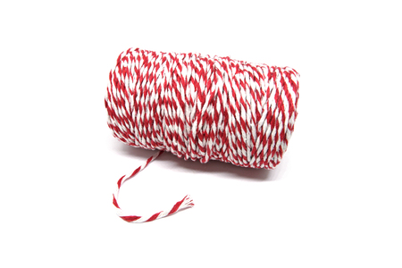 Roll of red and white rope for parcel isolated on white background.