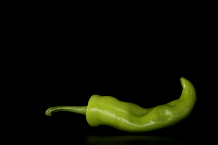 Green chili or Bell pepper isolated on black background. Food organic, Close up, Fresh pepper.