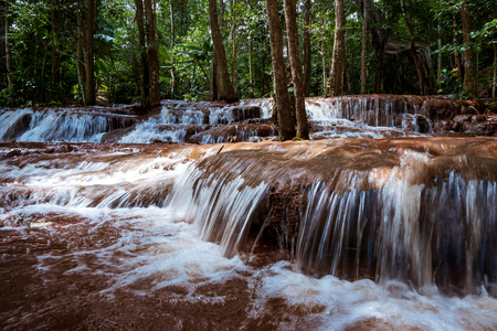 Pa Wai Waterfall is a small limestone cascade. Follow the slope of the mountain with more than 100 layers of natural wonders in Khiri Rat District, Phop Phra District, Tak Province, Thailand.