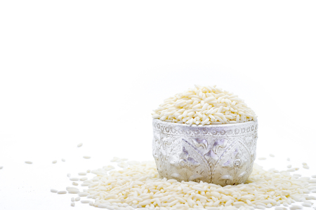Pile of glutinous rice on silver bowl isolated on white background.