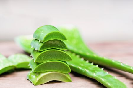 Aloe Vera sliced into pieces on wooden background, Gel in the leaves is a herbal treatment for the skin, Similar to the crocodiles tail,
