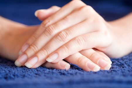 Close-Up fingernail of women on blue towel, Concept of health care of the fingernail. 版權商用圖片