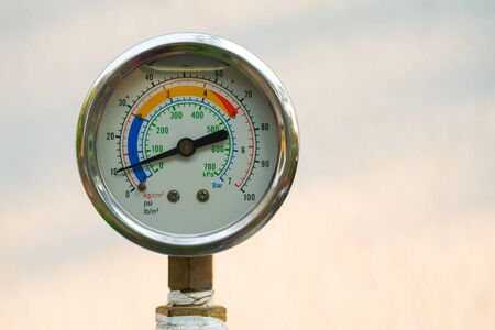 Close up water pressure gauge on natural blur background, Free copy space.
