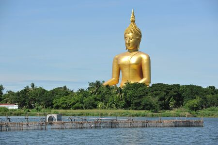 Angthong, Thailand - June 19, 2010: Giant statue of Buddha sits peacefully at Wat Muang temple.