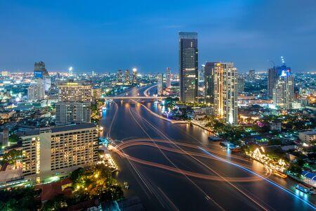 chao phraya river: Bangkok, Thailand - October 28, 2012: Blurred motion of running boats creates lines along Chao Phraya river.