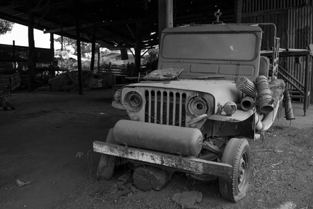 abandoned car: Pijit, Thailand - March 30, 2013: Abandoned car is covered with dust and debris.