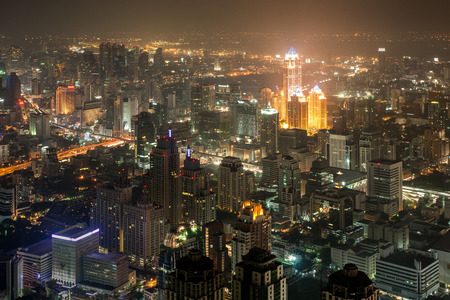 View of downtown Bangkok at night with light and buildings. photo