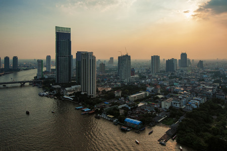 chao phraya river: View of Bangkok and Chao Phraya river with buildings hit by the sunlight in the late afternoon. Stock Photo