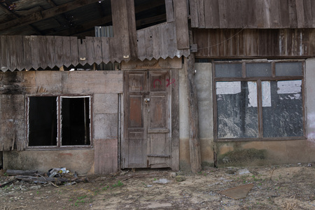 windows and doors: Doors and windows of abandoned wooden house.