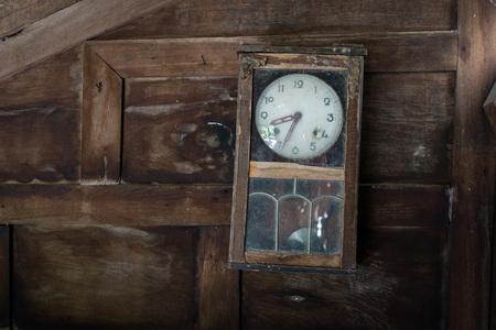 pendulum: Broken pendulum clock on old wooden wall. Stock Photo