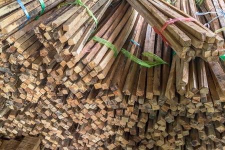 treated board: Pile of rough sawn timber in warehouse.