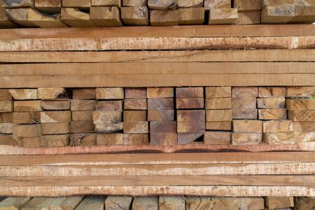 Pattern of rough sawn timber in warehouse. Stock Photo