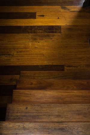 parquetry: Light and shadow of brown wooden stairs and parquetry.