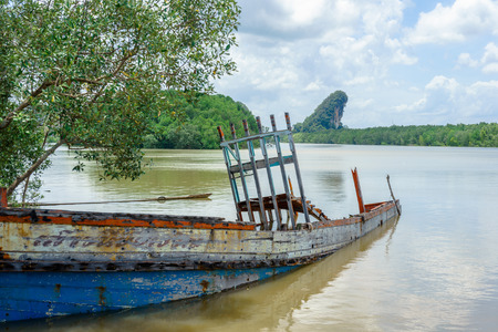 Shipwreck in the river near mangrove forest in Krabi, Thailand. Stock Photo