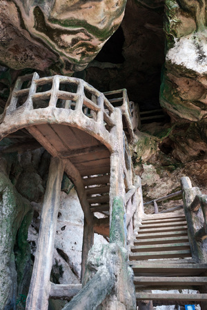 man made: Man made stairs into dark rocky cave.