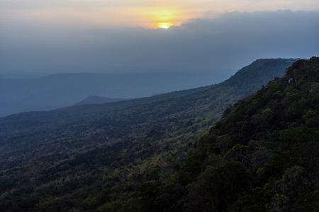 Sunset on the cloudy sky over dark mountain range at Phu Kradueng, Thailand. 版權商用圖片