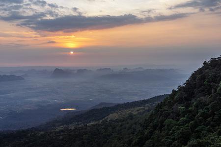 Orange sunrise sky with mountain range view at Phu Kradueng, Thailand.