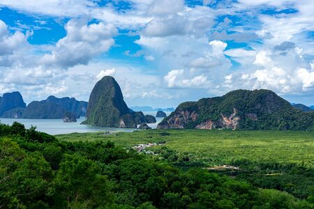 Green forest with limestone islands and mountains in Phang Nga Bay, Thailand.