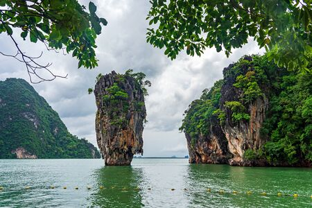 Famous Koh Tapu limestone island, also known as island green sea and cloudy sky in Phang Nga bay, Thailand.