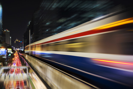 Speed motion Blur from Sky Train at night in modern city (background) Stock Photo - 80382130