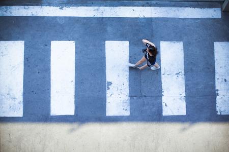 Woman walk crossing in crossing zone top angle Reklamní fotografie - 80001814