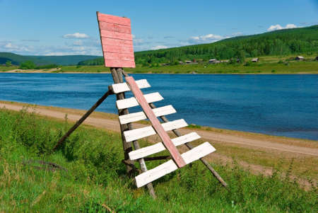 A wooden navigation sign on the river Stock Photo