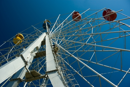 Ferris Wheel over blue sky Stock Photo