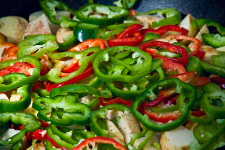 Slice red and green peppers