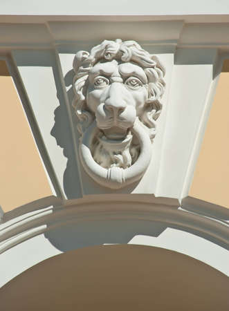 Stone head of lion on a building in St. Petersburg, Russia