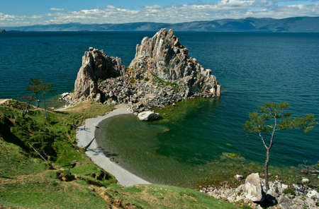 Shaman rock and cape Burhan on Olkhon Island, Baikal Lake, Russia Stock Photo