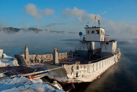 Ferryboat moored at pier in a winter mornings