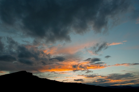Silhouette of hill at sunset