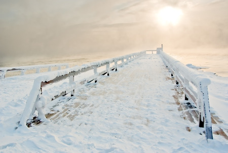 Snowbound jetty on Lake Baikal winter morning