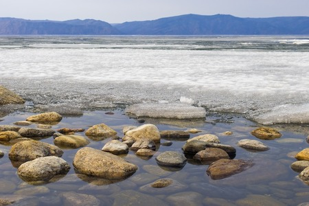 Early spring. Landscape with lake Baikal, Russia. photo